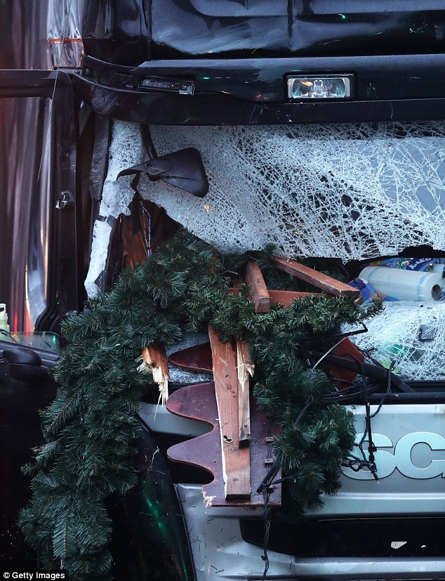Close up: The shattered glass on the windshield of a truck the morning after it ploughed through the Christmas market