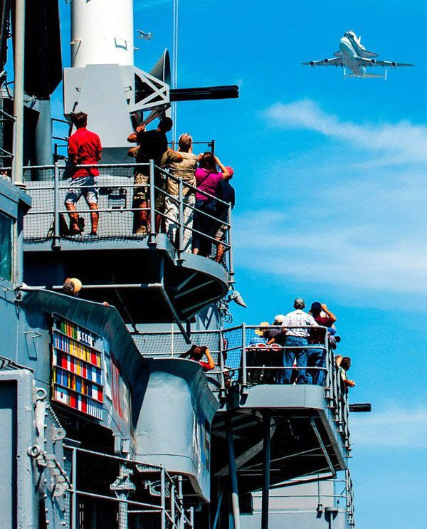 Endeavour and NASA 905 fly over the retired battleship USS Iowa in San Pedro on September 21, 2012.