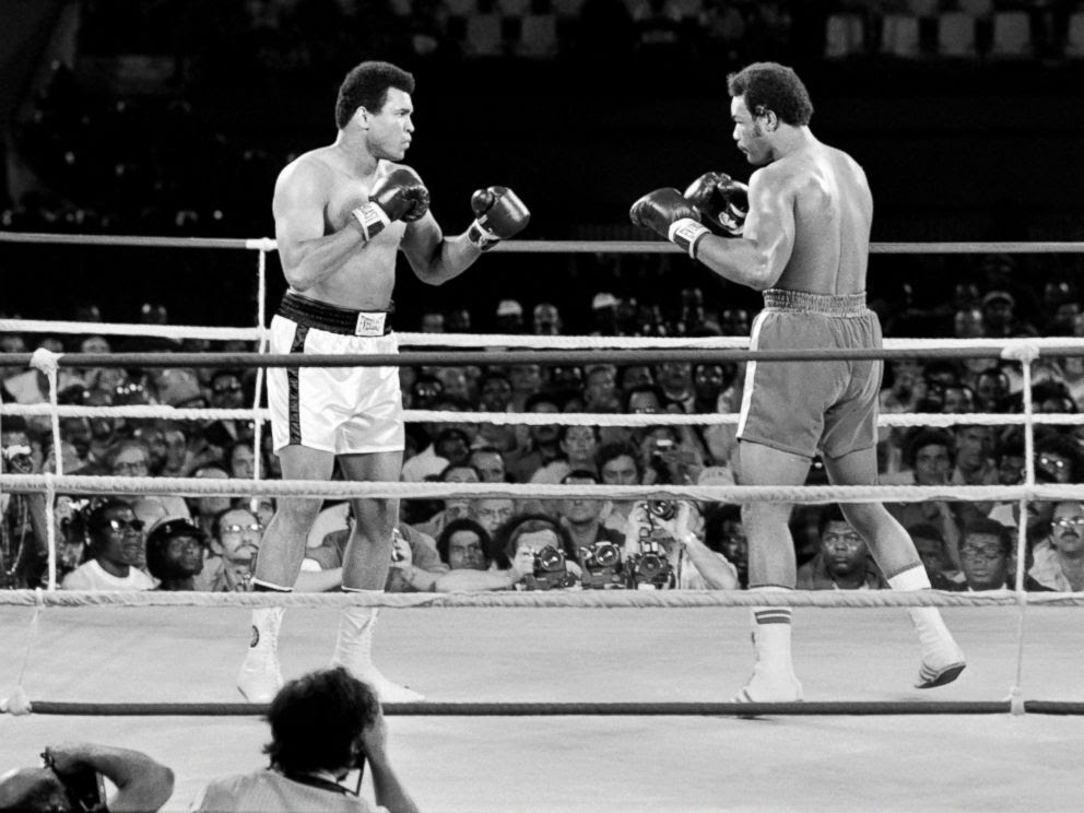 PHOTO: Heavyweight champions, Muhammad Ali, born Cassius Clay, left, and George Foreman in the ring in Kinshasa, Oct. 30, 1974.
