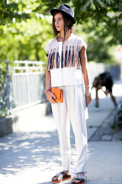 Le Fashion Blog Street Style Nyfw Boho Eclectic Look Black Hat Contrast Linen Top With Bright Fringe Details Orange Clutch White Pants Embellished Slide Sandals Via Popsugar