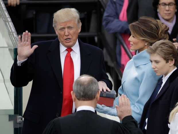 Donald Trump is sworn in as the 45th president of the United States by Chief Justice John Roberts as Melania Trump looks on during the 58th Presidential Inauguration at the Capitol in Washington, Friday, Jan. 20, 2017.