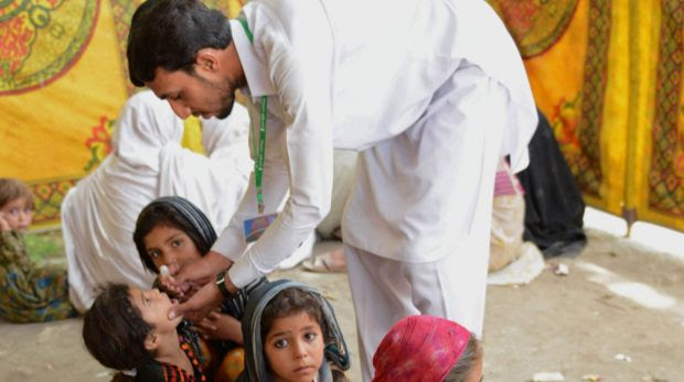 A Pakistani health worker in Bannu giving  the polio vaccine to children last year.