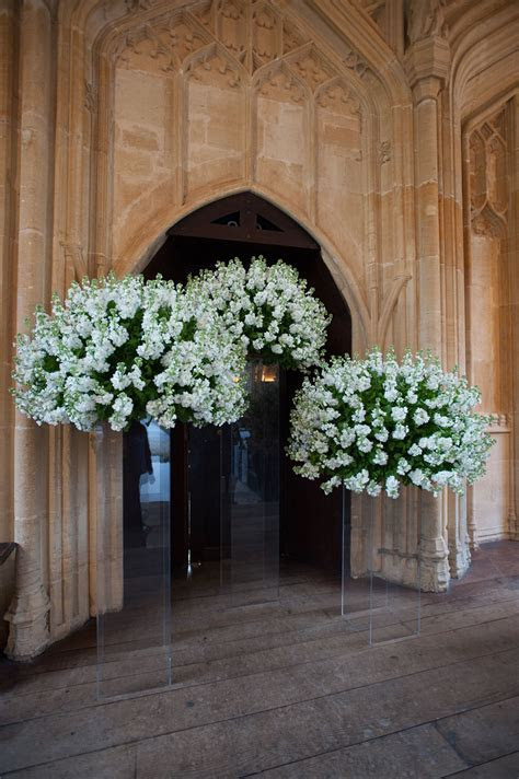 Flower arrangements on clear stands make them appear to be