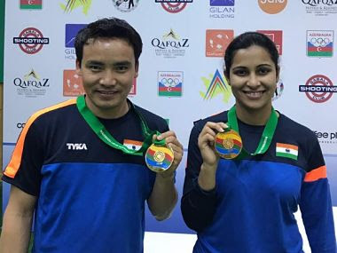 India's Jitu Rai and Heena Sidhu pose after winning gold in 10m air pistol event at the ISSF World Cup.
