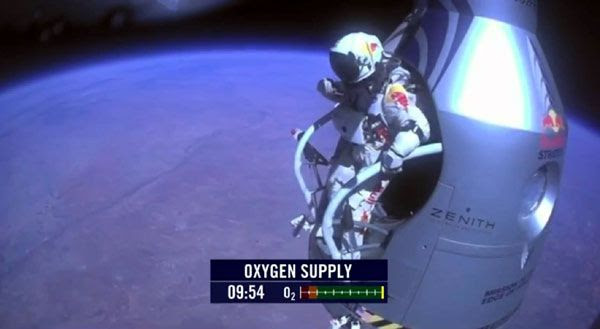 Austrian BASE jumper Felix Baumgartner is about to spacedive from an altitude of 128,100 feet on October 14, 2012.