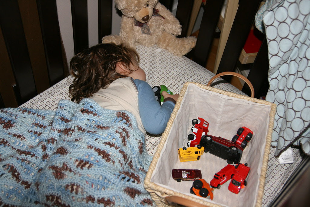 sleeping with his car collection