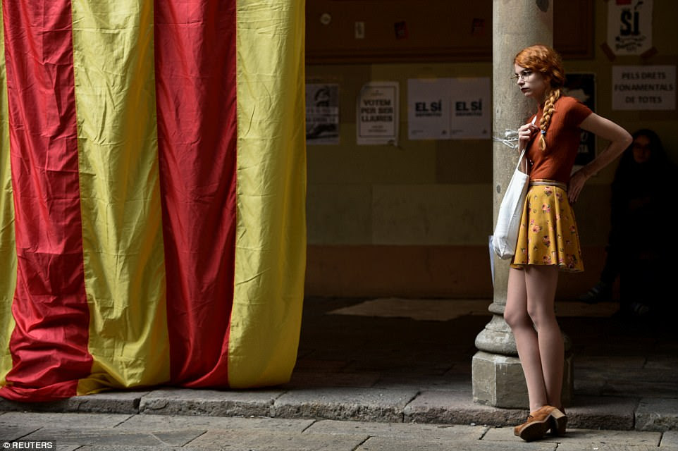 A student stands next to a huge Estelada - the Catalan separatist flag - inside the University of Barcelona the day after the banned independence referendum in Barcelona, Spain, on October 2. President of CataloniaCarles Puigdemont would later flee the country in the unrest that followed