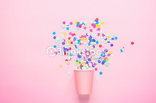 Drinking Paper Cup With Multicolored Confetti Scattered On Fuchsia