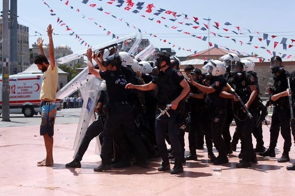 A protester comes out with his hands in the air (photo by Yucel Tunca)