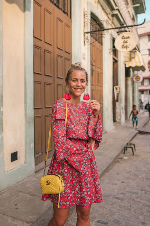 Le Fashion Blog Summer Dressing Flower Print Red Dress Yellow Gucci Bag Flat Sandals Tassle Earrings Via Janni Deler