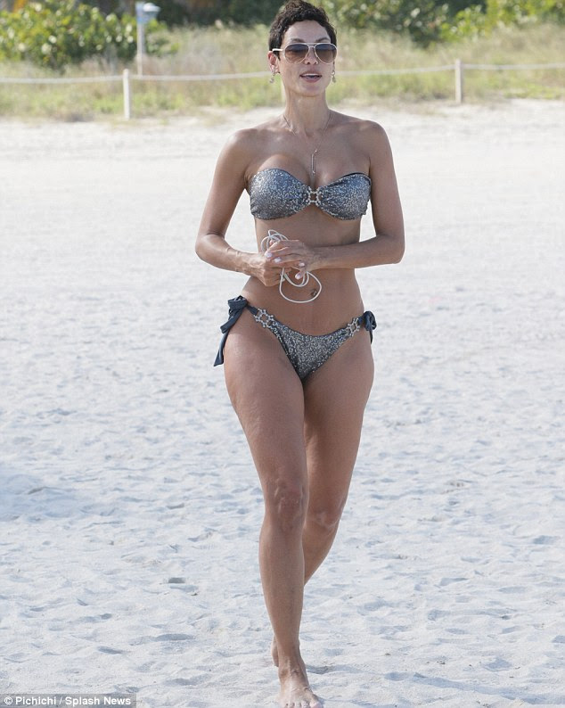 Amazing shape: The 47-year-old beauty - who was previously engaged to Michael Strahan - turned heads showing off her enviable figure in a metallic bikini
