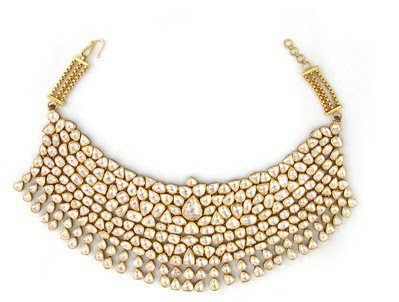 02 A gold and diamond bib necklace