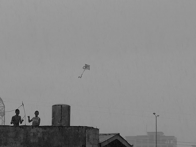 Flying kite in the rain. Photographed by Bernard Eirrol Tugade