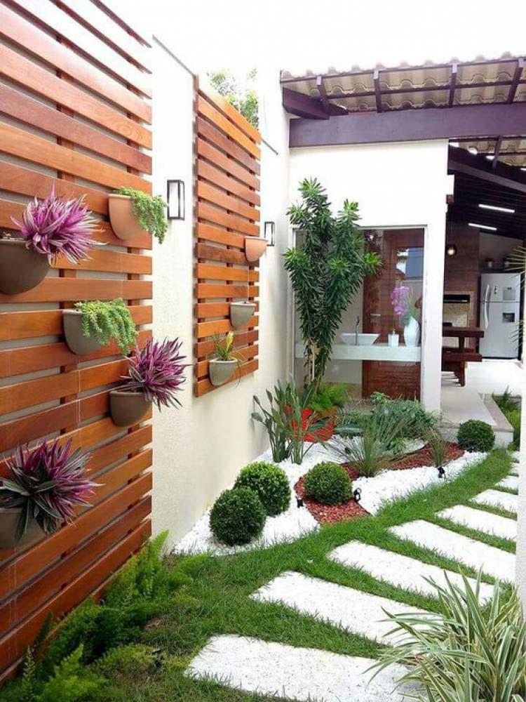 Jardim de inverno na entrada da casa