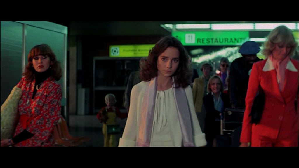 Woman at airport (Daria Nicolodi, left, screenwriter and partner of director) in Suspiria (1977)