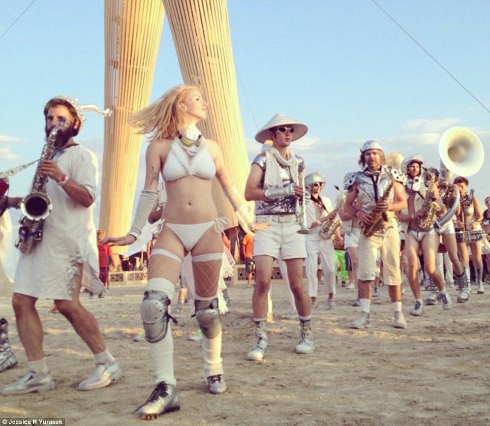 All white: Revelers in white frolic at the Burning Man festival