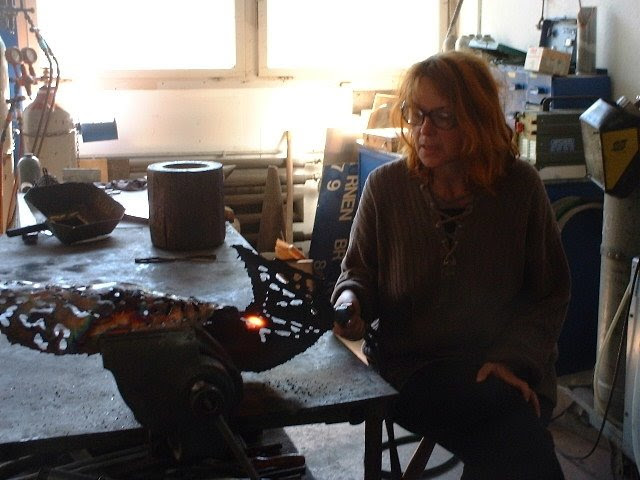 THE ARTIST BARBARA STREIFF BY BURNING FIRST SYMBOLS ON COPPER