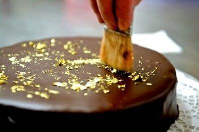 Decorating a chocolate cake with gold leaf This is what we