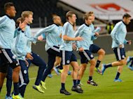 Germany players take part in a training session on October 14, 2013, the eve of their World Cup qualifier against Sweden in Solna
