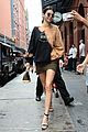 kendall jenner shows off her legs in olive green skirt and oversized sweatshirt 04