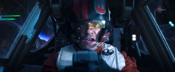 Poe Dameron (Oscar Isaac) pilots his Resistance X-Wing fighter through a space battle in STAR WARS: THE FORCE AWAKENS.
