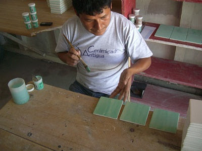 Making Hand Painted Ceramic Field Tile - Step 4: The Glazed Tile is Set Down.