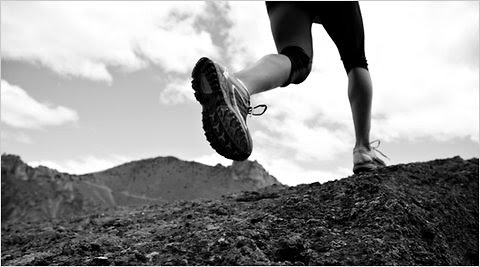 Does it take more work to run in sneakers or barefoot?