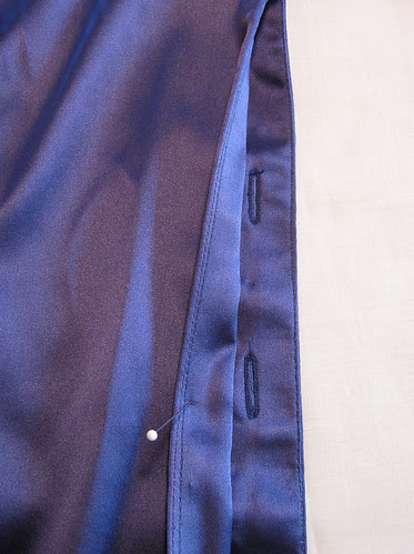Blue silk blouse buttonholes