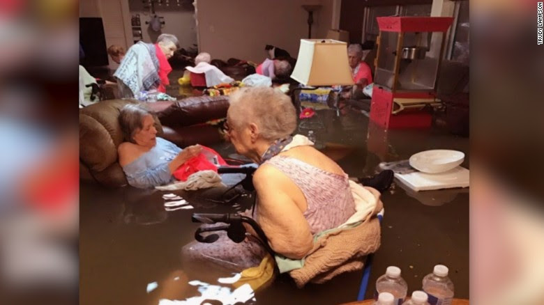 Nursing home residents in Dickinson, Texas, wait for first responders in a flooded room.
