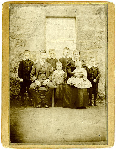 Family and stone house
