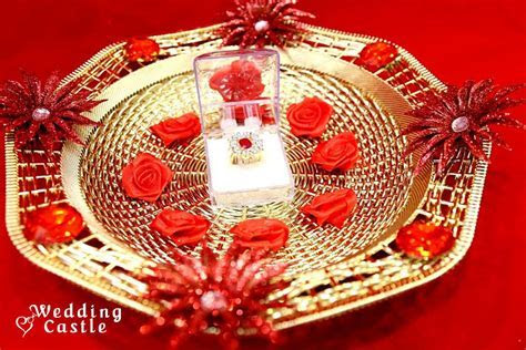 Golden Ring Ceremony Tray with Red Flowers and Ring