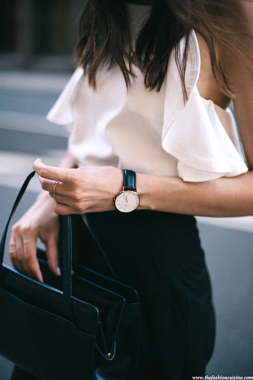 Le Fashion Blog Blogger Style Masculine Meets Feminine Look Sleeveless Ruffled White Blouse Classic Watch Leather Shoulder Bag Dainty Rings Black Pants Via The Fashion Cuisine