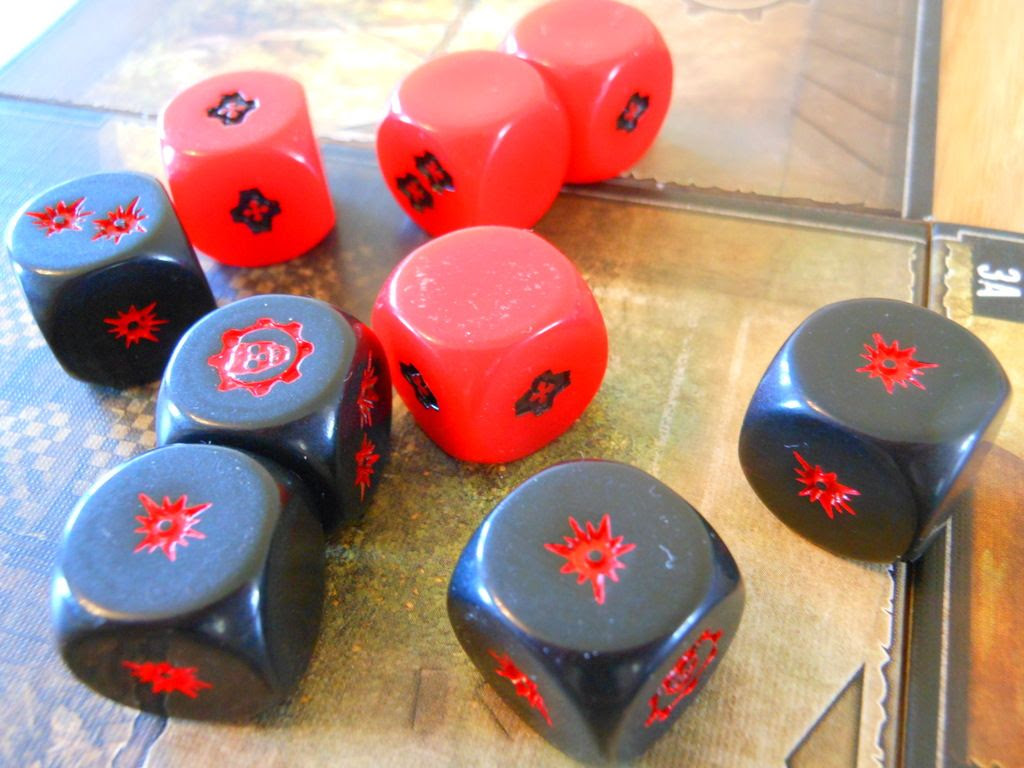 Red and black custom dice from Gears of War, rolled on the game board.
