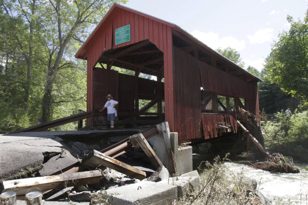 A damaged historic covered bridge spans Cox Brook in Northfield, Vt., Monday, Aug. 29, 2011, the day after Tropical Storm Irene dumped heavy rainfall across the region, causing flash floods. (AP Photo