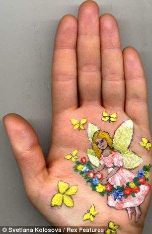 Whimsical: Svetlana Kolosova says she prefers to paint on the palm of her hand rather than use the more traditional canvas