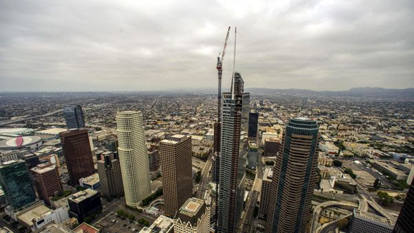 The Wilshire Grand Center stands tall in downtown Los Angeles after the final spire segment was installed atop the skyscraper on September 3, 2016.