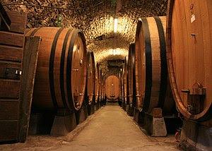 Oak barrels full of Chianti Classico wine in a...