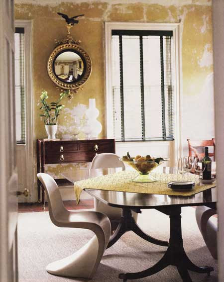 Dining-room-designed-and-furnished-with-extravagant-chairs-and-wooden-table