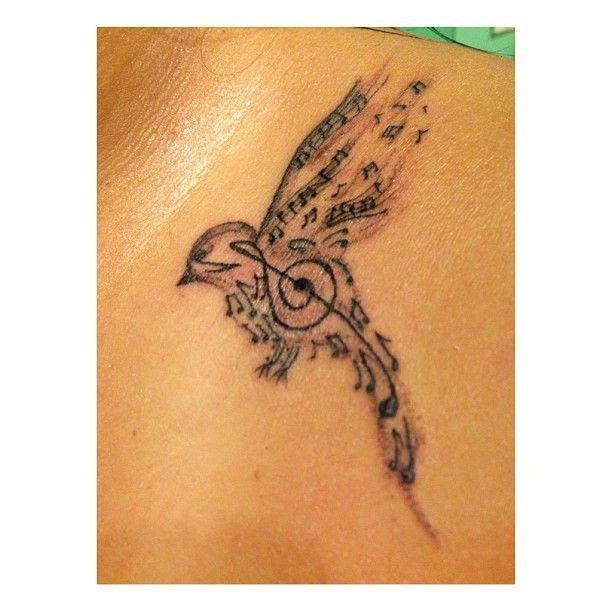 Lovely Music Bird Tattoo On Shoulder Tattoomagz