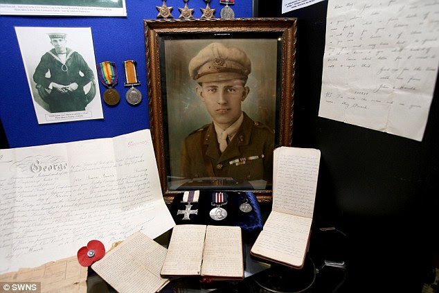 A photograph of sapper John French beside his medals and handwritten diaries which described truces in the trenches for moments of name-calling