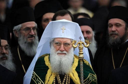 Newly elected, Bulgarian Orthodox Church Patriarch Neophyte stands among church bishops at the golden-domed
