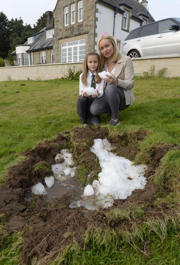 Huge chunk of ice scotland, megacryometeor scotland, huge megacryometeor makes crater in garden in scotland