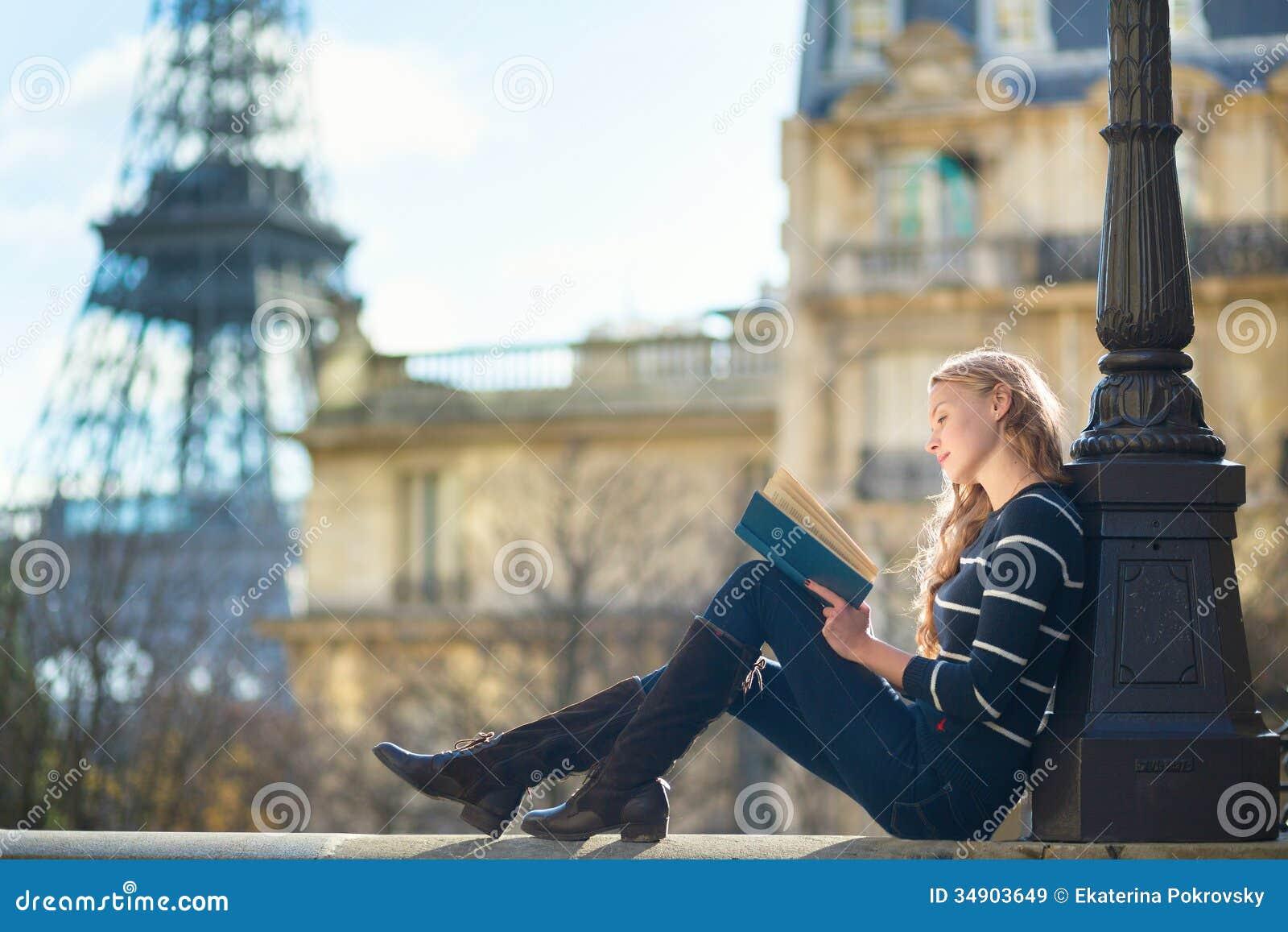 beautiful young woman paris reading book near eiffel tower 34903649