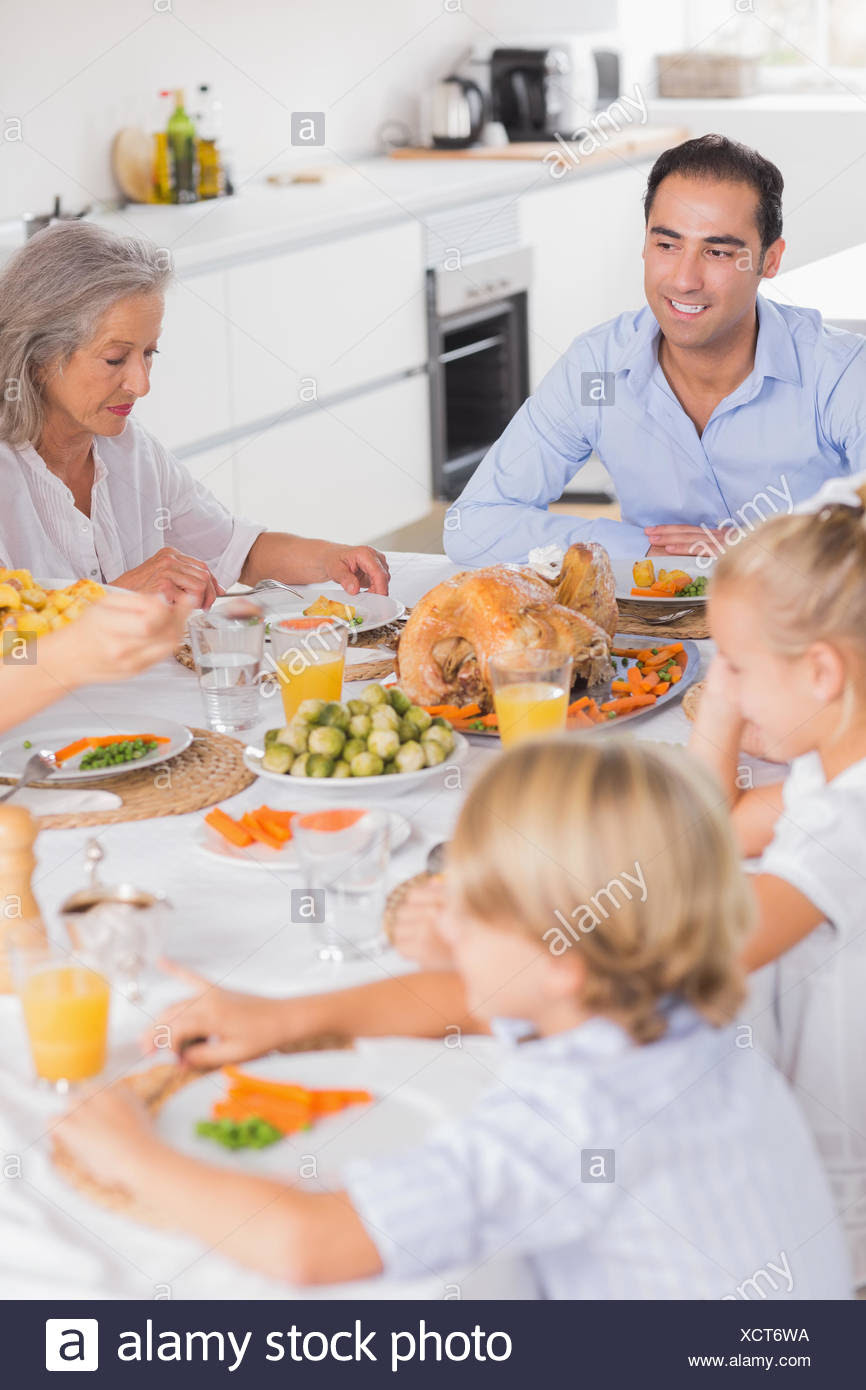 Family Eating Thanksgiving Dinner Together Stock Photo 283274022