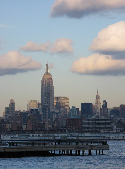 puffy clouds and the Empire State Building from the Jersey side, Hudson River, NYC