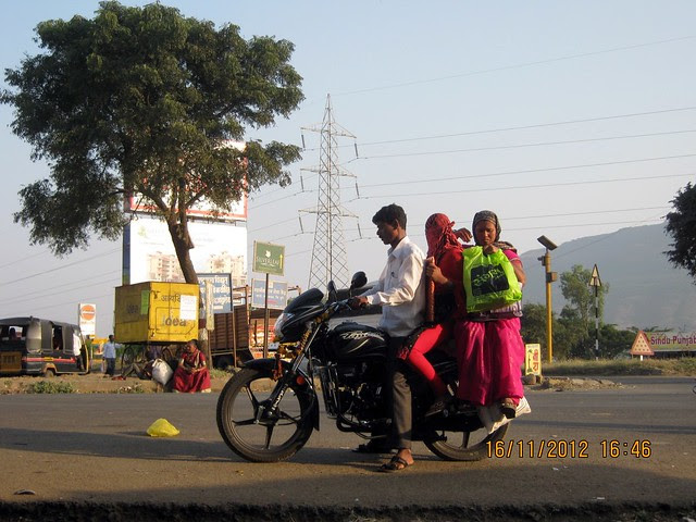Three on Motorcycle at Kanhe
