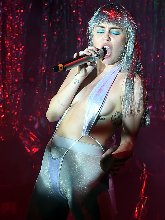 miley topless with mirror pasties