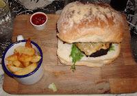 Burger resting in a Belfast Bap in Made in Belfast, Wellington Street, Belfast