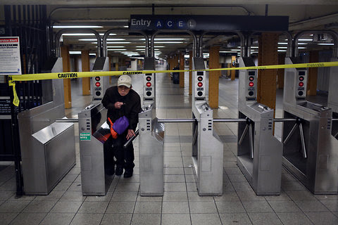 A subway rider exits the 14th Street station.