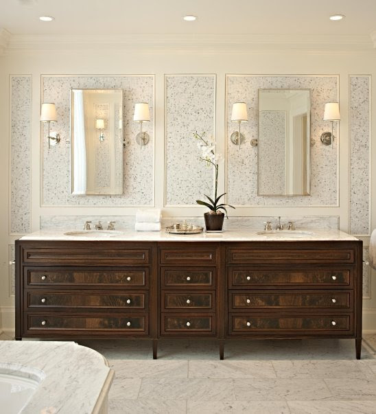 Gorgeous, chic bathroom design with marble floor tiles, wood vanity